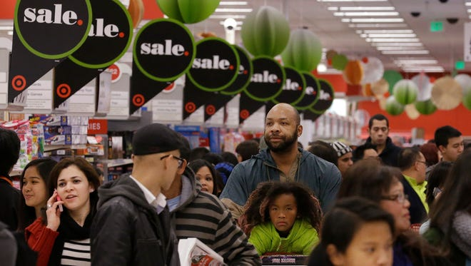 Shoppers look for deals during 2013 Black Friday in this national wire photo.