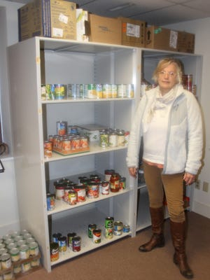 Kristie Yoder helps oversee the new food bank at Amana Church.