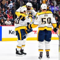 Predators clinch playoff spot, increase lead in NHL standings by toppling Avalanche
