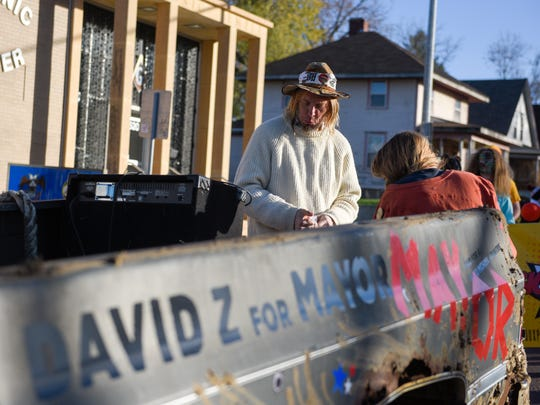 Mayoral candidate David Zokaites (center) prepares his float before the Zombie Walk on Saturday, Oct. 28, 2017.