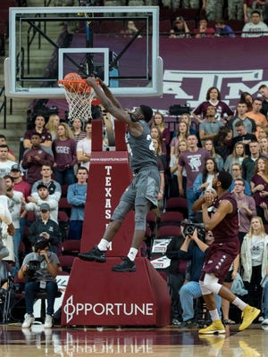 Feb 20, 2018; College Station, TX, USA; Mississippi State Bulldogs forward Abdul Ado (24) dunks the ball over Texas A&M Aggies center Tonny Trocha-Morelos (10) during the second half at Reed Arena. Mandatory Credit: C. Morgan Engel-USA TODAY Sports
