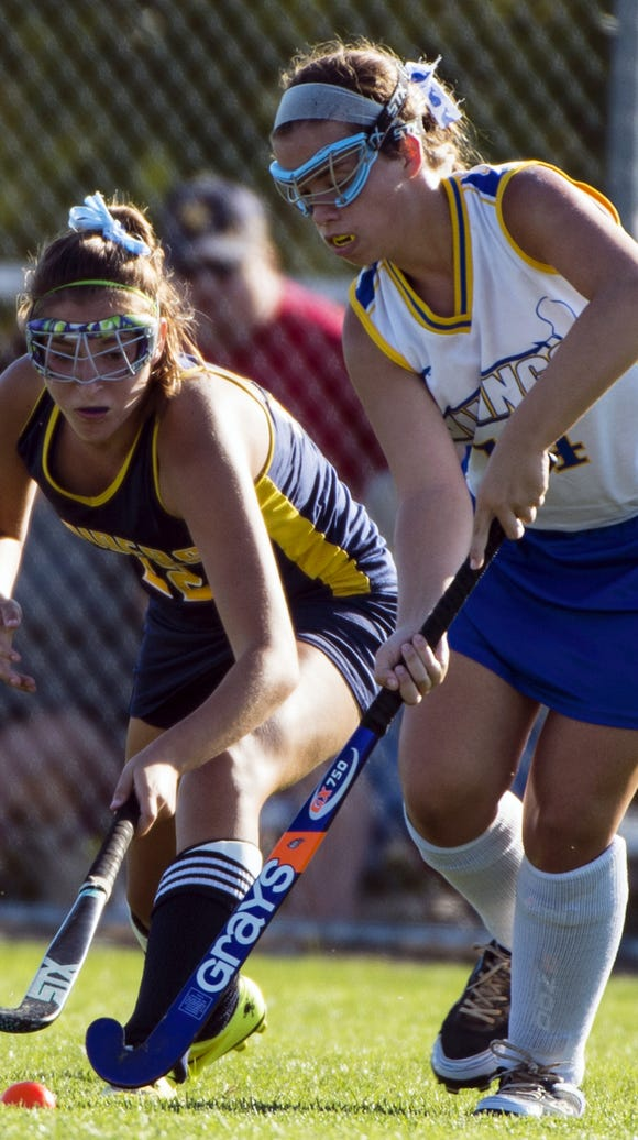 Elco's Katie Fields, left, scored four goals in a win
