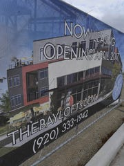 An artist's rendition on a banner of The Bay Lofts
