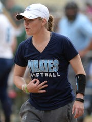 Former Bay Port softball coach Jenna Woepse signals a baserunner during the WIAA postseason in 2015.