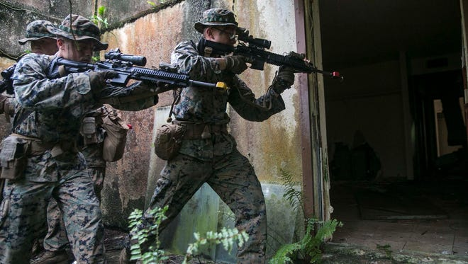 In this Aug. 30, 2017, file photo, Marines with Battalion Landing Team, 3rd Battalion, 5th Marines, clear an abandoned house during Military Operations in Urbanized Terrain training at Andersen South. A buildup forum will be held March 7-9 at the Dusit Thani Guam Resort.