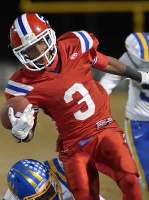 Douglas Collier/The Times Evangel's Corey Henderson runs for yardage against St. Paul's during their class 3A first round playoff game November 14, 2014. Henderson scored the winning touchdown in overtime bringing the Eagles a 43-36 victory.