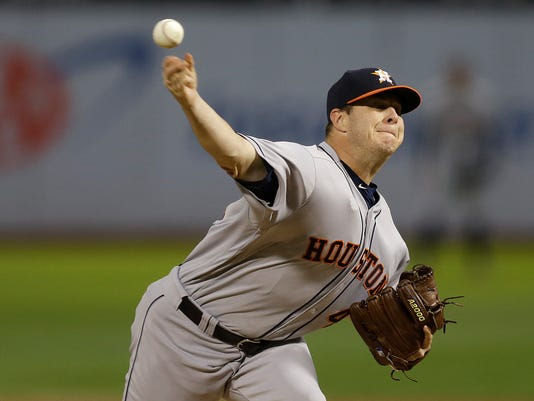 Houston Astros pitcher Brad Peacock works against the Oakland Athletics in the first inning of a baseball game Monday, Sept. 19, 2016, in Oakland, Calif. (AP Photo/Ben Margot)