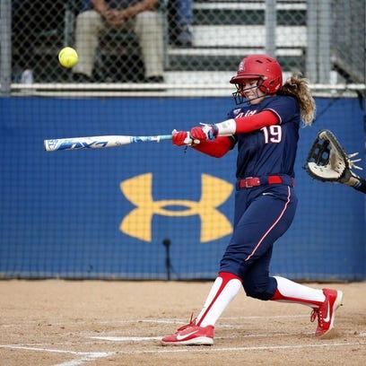 Arizona's Jessie Harper hits during an NCAA Tournament