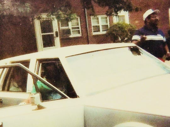 Red Bank football coach Ty Lewis picks Chris Melvin up to take him and other Buc players to football camp during the summer of 1987.