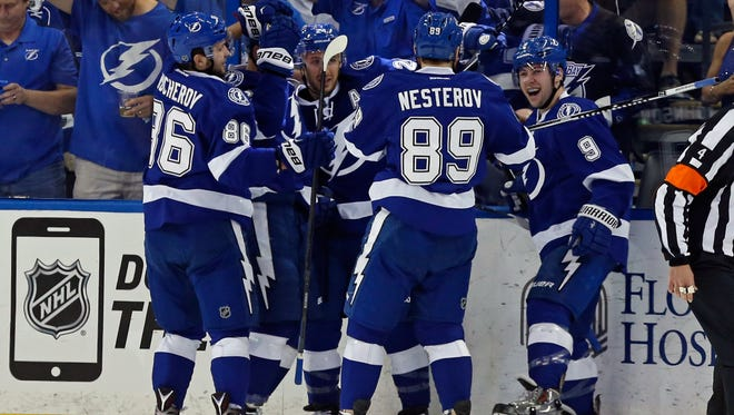 Tyler Johnson #9 of the Tampa Bay Lightning celebrates his first goal with teammates against the Detroit Red Wings in Game 2 of the Eastern Conference Quarterfinals during the 2015 NHL Stanley Cup Playoffs at Amalie Arena on April 18, 2015 in Tampa, Fla.