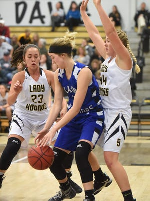 Cotter's Alexa Wooten is defended by Salem's Kaylea Walling (left) and Madison Sellars (right) on Tuesday night.
