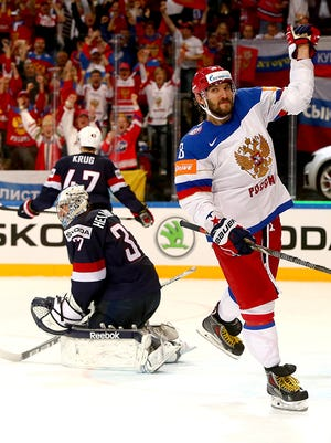 Alex Ovechkin of Russia scores against the United States on Saturday.