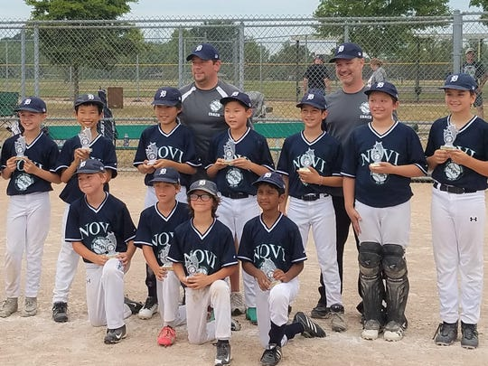 The 10-and-under champion of the Novi Youth Basebal League's Mustang Division were the Tigers.