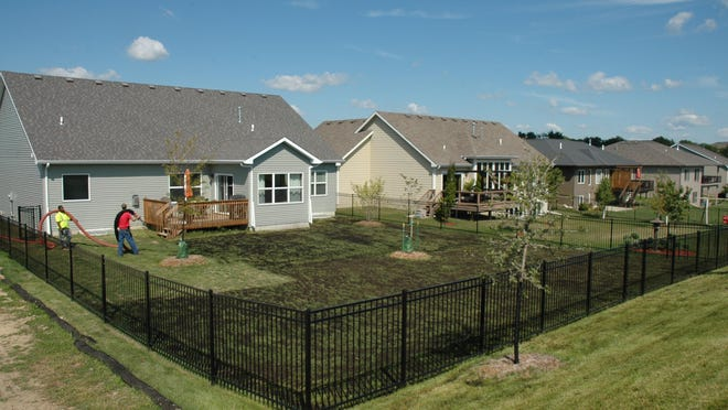A home in the Easter Lake area undergoes soil quality restoration in which the lawn is aerated — with plugs cut from the soil. Compost is then laid over the top, eventually working its way into the soil to improve the overall health.