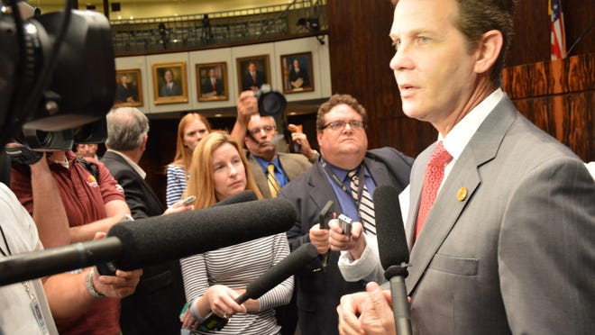 Senate President Andy Gardiner, R-Orlando, talks with reporters after the Senate session this morning.