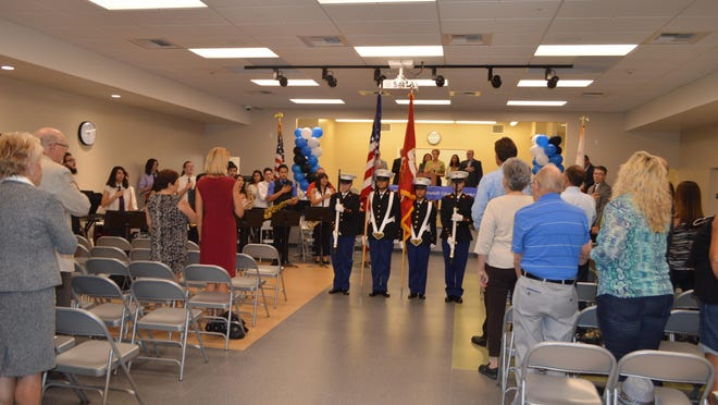 The Desert Hot Springs High Jr ROTC color guard performs during a dedication ceremony for a new alternative education center.