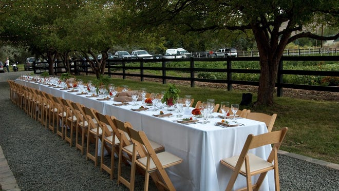 Tables are set up to host guests who will be served locally produced vegetables, fruits and flowers at Table Mountain Farm near Golden, Colo., in 2012.