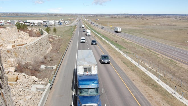 Traffic passes under the Interstate 25 overpass for Colorado Highway 392 outside of Windsor.