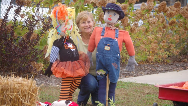 """Tracy Munn shows off a couple of the schoolchildren's """"funcrows."""""""