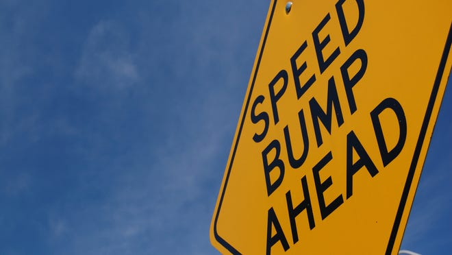 "A sign that says ""speed bump ahead."""