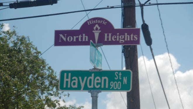 A decorative North Heights street sign topper was unveiled on Wednesday at the intersection of NW 9th Avenue and N. Hayden Street.