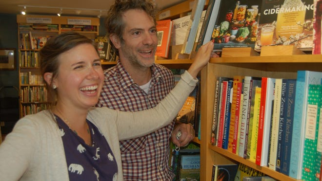 Kazmira and Jonathan Nedeau check out books on fermenting and cider making at their new store, Sea Howl Bookshop, in Orleans.