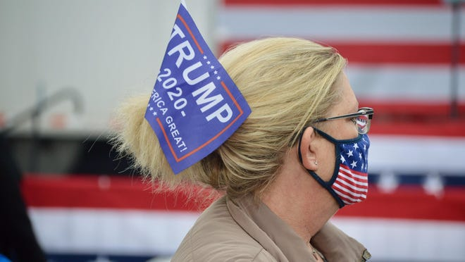 """Supporters of President Donald Trump and Vice President Mike Pence await Pence's arrival Wednesday, Oct. 14, 2020, at a """"Make America Great Again,"""" rally at Lacks Enterprises in Grand Rapids, Mich."""