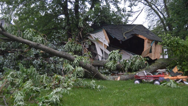 A wind gust tore a massive branch from a tree Tuesday, June 9, destroying a shed at 340 W. 14th Street. Strong storms caused additional damage across the Holland area Wednesday, June 10.