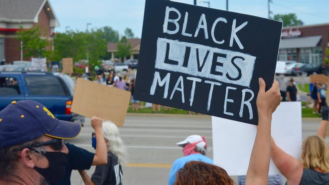 About 3,000 Black Lives Matter supporters marched to the Unity Bridge Sunday, June 7.
