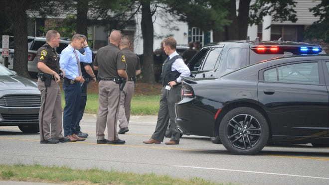 Police respond to reports of a shooting in the area of the 500 block of 136th Avenue in Holland Township Wednesday, July15.