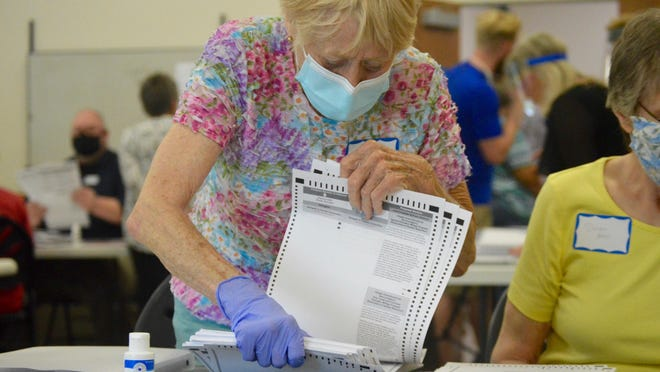 A poll worker counts Allegan County ballots Wednesday, Sept. 2, at Allegan Township Hall. Mike Villar challenged the Republican primary results after he lost by 19 votes to incumbent Allegan County Prosecutor Myrene Koch.