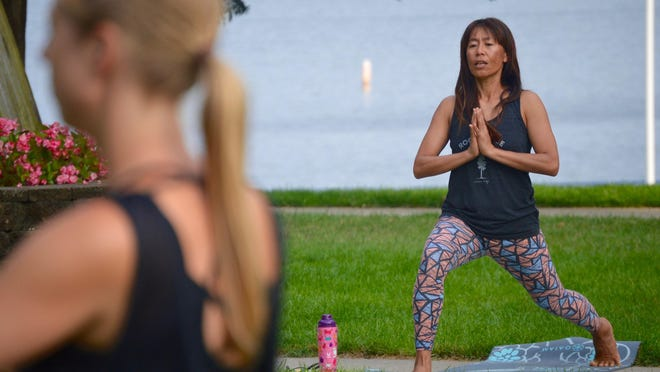 Yoga instructor Ria Nieboer leads Bodhi Tree's Yoga in the Park session July 18. Bodhi Tree Yoga & Wellness was one of 428 small businesses in Allegan and Ottawa counties to receive grant money through the Michigan Small Business Restart Program.