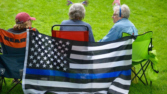 "A crowd of 250 supporters gathered Saturday, Aug. 1, at Centennial Park to rally behind law enforcement at a ""Back the Blue"" event."