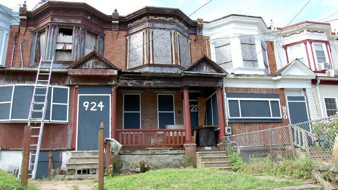 Camden abandoned home being beautified by Camden Community Development Association