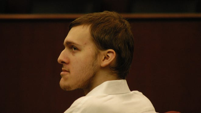 Zachary Davis listens to testimony during his murder trial.
