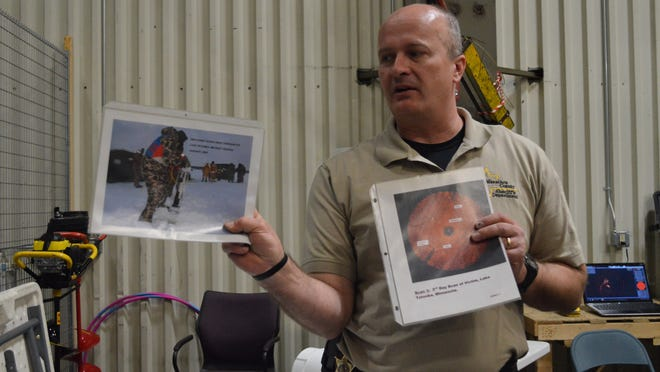 Marathon County Sheriff's Department Lt. Mark Wagers shows images of a dive team investigation to participants of the department's citizens academy.