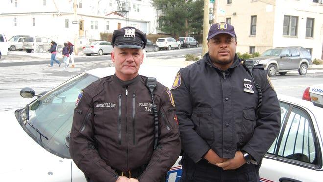Yonkers police Officers Leslie Hand, left, and Stuart Barksdale.