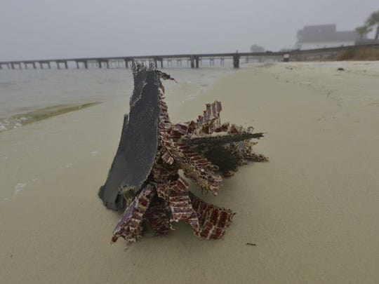 A piece of downed helicopter washed ashore in Navarre.