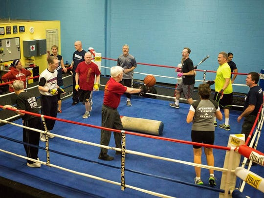 Boxers develop agility through ring drills. Trainers