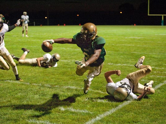 York Catholic's Qua'shawn Grooms (21) dives toward the goal line, going out of bounds at the 2-yard line during a football game against Delone Catholic. (Jeff Lautenberger -- For the Daily Record/Sunday News)