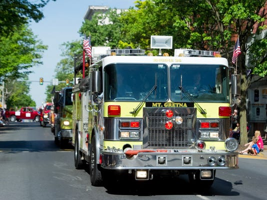 A Mt. Gretna Community Volunteer Fire Co. engine rolls down Cumberland Street during this year's Memorial Day Parade in Lebanon.