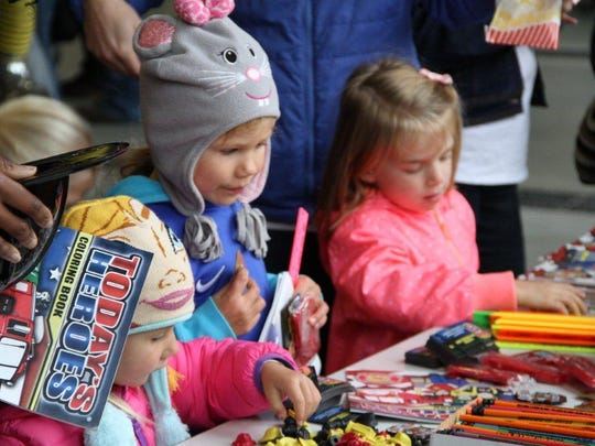 Children got coloring books, pencils and other gifts during the fire department's open house.