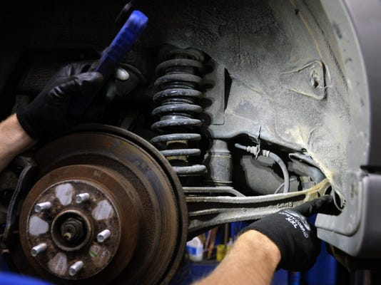 Service manager Chad Fadely points out a tie rod that needs to be replaced as he demonstrates a safety inspection on a Subaru on Friday, June 26, 2015, at Fadely's Auto Masters + Tires in West Manchester Township. Chris Dunn Ñ Daily Record/Sunday News