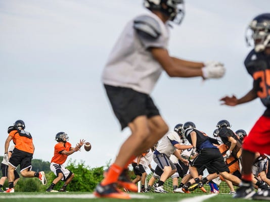 Northeastern quarterback Marcus Josey takes a snap during practice in late July. The Bobcats open this season against York Catholic, which has provided two close games the past two years. (Jeff Lautenberger -- For GameTimePA.com)