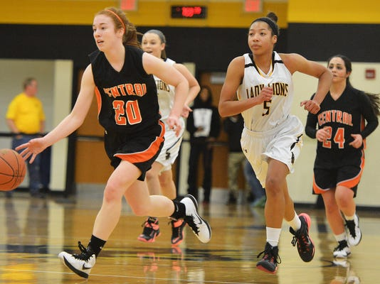 Central York's Emma Saxton (20) dribbles upcourt in a YAIAA girls' basketball game against Red Lion on Jan. 16. Central York won, 30-18. ( Jeff Lautenberger - — For GameTimePA.com)