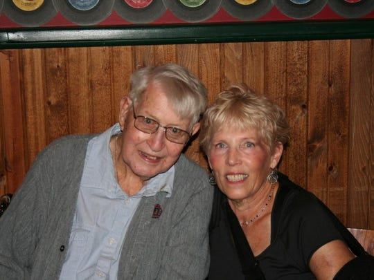 LEFT: John McAuliffe and professional photo organizer Marianne Behler at his book-signing party in August.