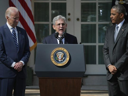 President Barack Obama and Vice President Joe Biden listen as Judge Merrick Garland, the president's nominee to replace the late Supreme Court Justice Antonin Scalia, delivers remarks in the Rose Garden at the White House on March 16.