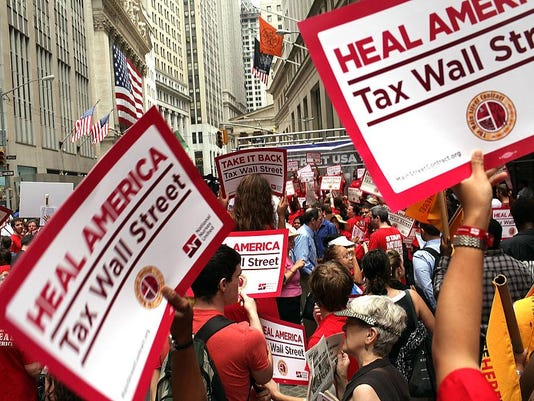 Activists March On Wall Street To Hold Institutions Accountable For Financial Global Crisis