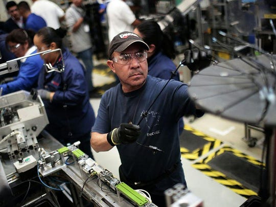 At work in the auto parts production line in the Bosch factory in San Luis Potosi, Mexico, in this file photo from January 11, 2017. President Donald Trump has threatened to impose a 35 percent import tariff on companies that ship jobs to Mexico.