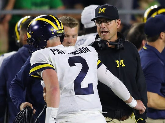 SOUTH BEND, IN - SEPTEMBER 01: Head coach Jim Harbaugh talks to Shea Patterson #2 of the Michigan Wolverines while playing the Notre Dame Fighting Irish at Notre Dame Stadium on September 1, 2018 in South Bend, Indiana. Notre Dame won the game 24-17. (Photo by Gregory Shamus/Getty Images)